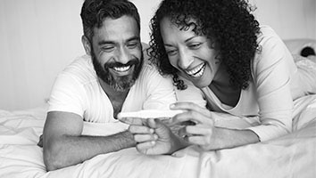 Smiling couple looking at pregnancy test