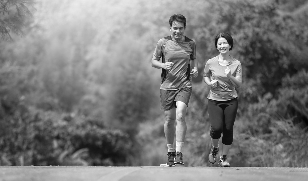 Couple keeping active by running